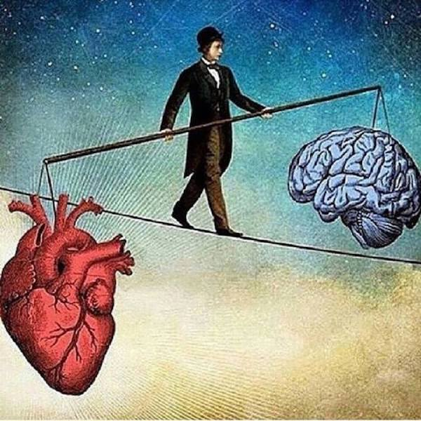 man walking on small path balancing a stick with heart and mind